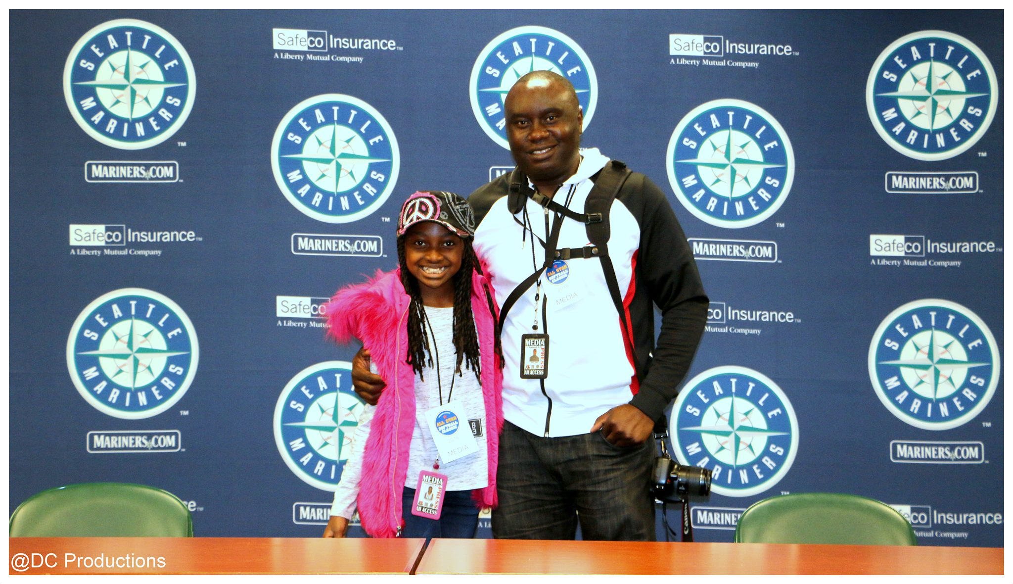 Davies Chirwa Mentoring 11 year old Thandi Chirwa on Professional Sports Media Coverage at Safeco Field in Seattle.
