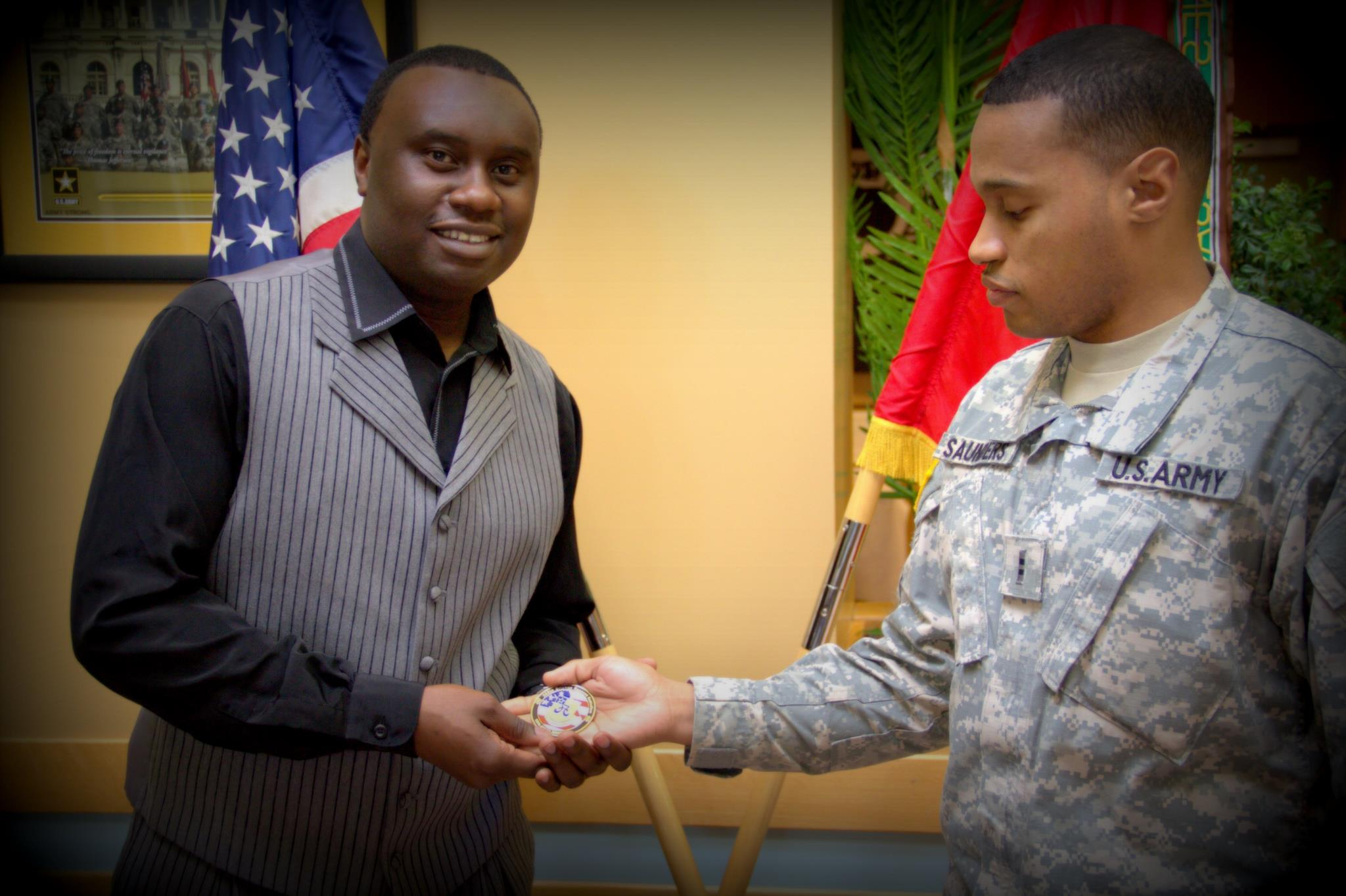 Davies Chirwa receiving a medal of honor for community leadership from The U.S Troops